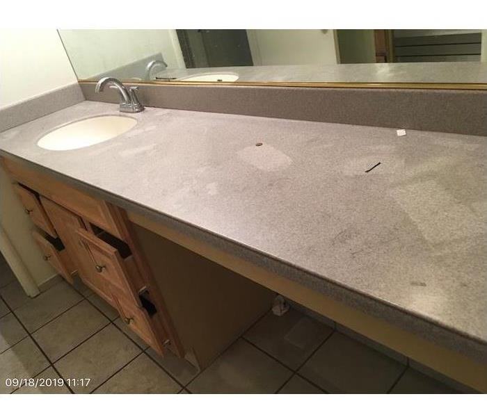 Bathroom with smoke damage on the countertops