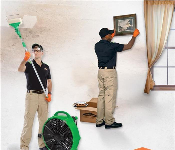 Picture of SERVPRO technicians cleaning