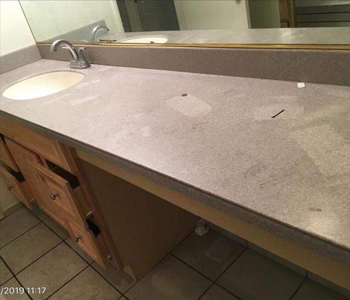 Soot damage on a bathroom counter top.