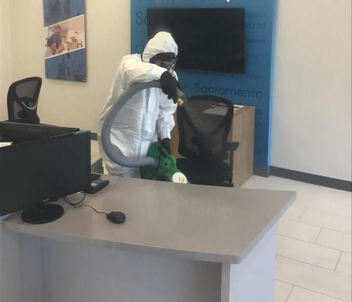 SERVPRO technician disinfecting an office